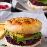Vegan quinoa beet burgers on parchment paper.