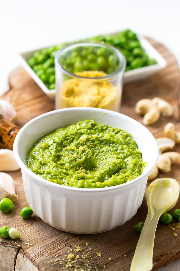This Creamy Cashew Pea Pesto is loaded with spring veggies and so delicious that you'll want to put it on everything!