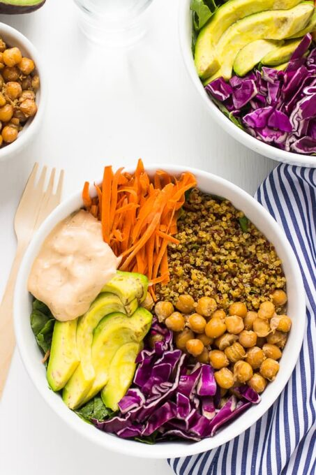 Top down shot of nourish buddha bowl on a white table.