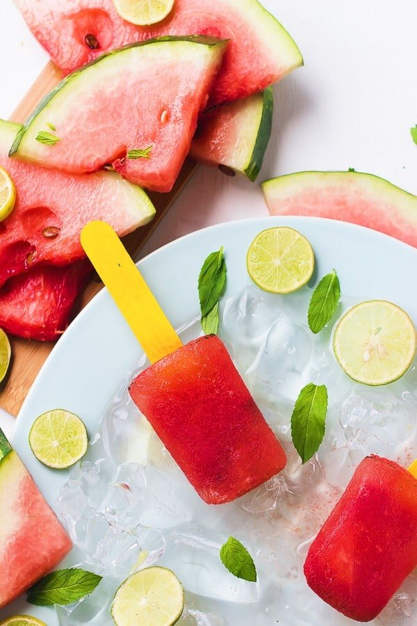 Top down shot of watermelon mint popsicles on ice.