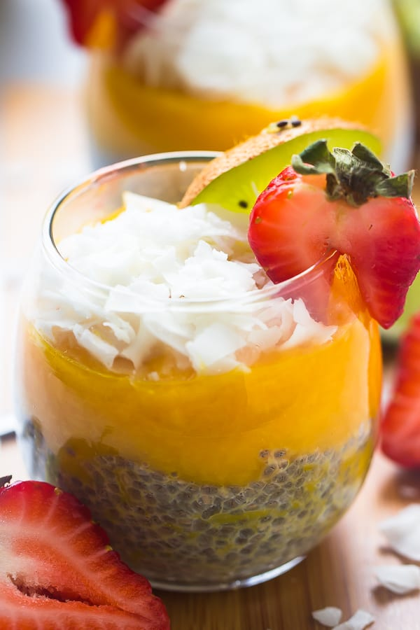 Close up of no bake mango coconut chia pudding in a glass.