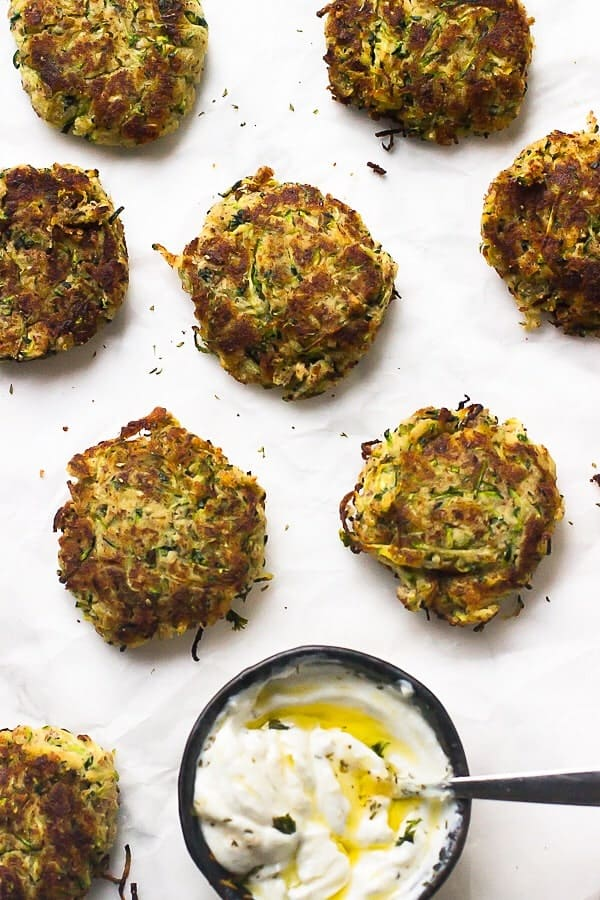 These Vegan Zucchini Fritters are gluten free, crisp on the outside and soft and flavourful on the inside! All in under 30 minutes.
