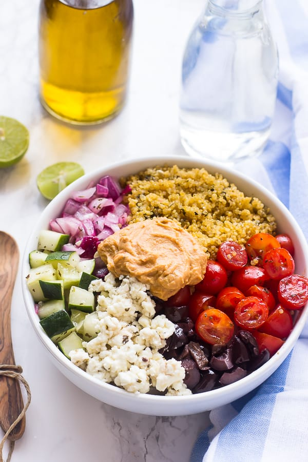 Overhead shot of mediterranean quinoa salad bowl on a table.