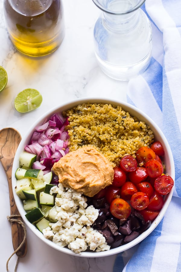 Overhead shot of Mediterranean salad bowl with a wedge of lime on the side.