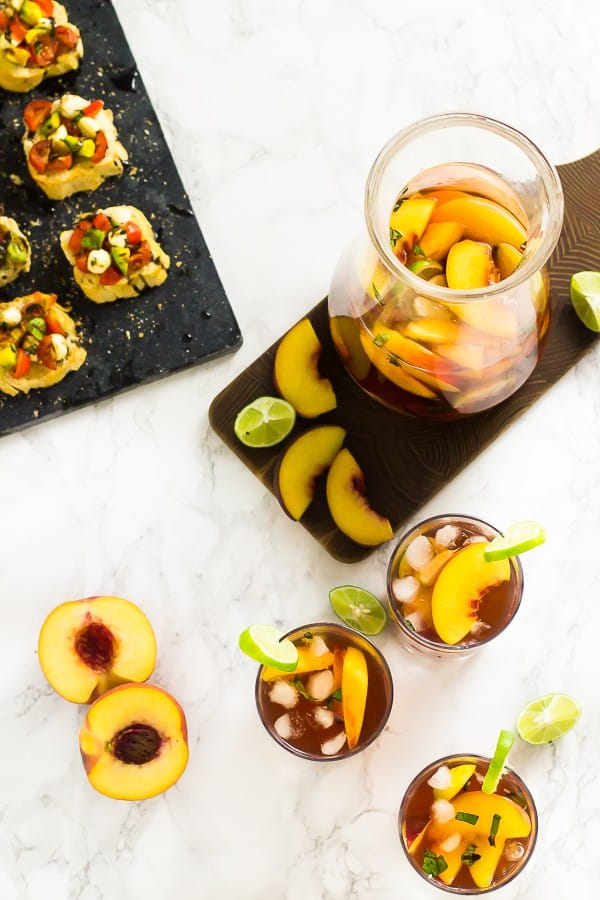 This Peach Stone Fruit Sangria is about to become your new favourite sangria!! Loaded with delicious sweet peaches and plums you can't stop at one glass! via https://jessicainthekitchen.com