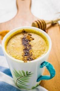 Looking down on a mug of pumpkin spice golden milk.