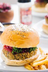 A vegan quinoa cauliflower burger with fries.