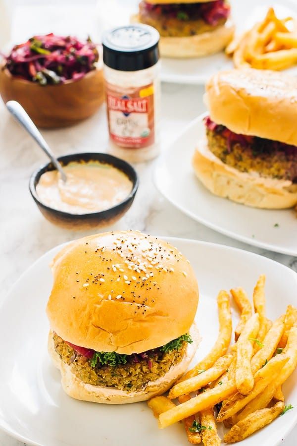 A quinoa and cauliflower burger with fries on the side.