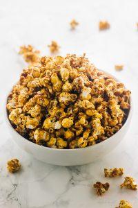 A bowl full of vegan salted caramel popcorn.