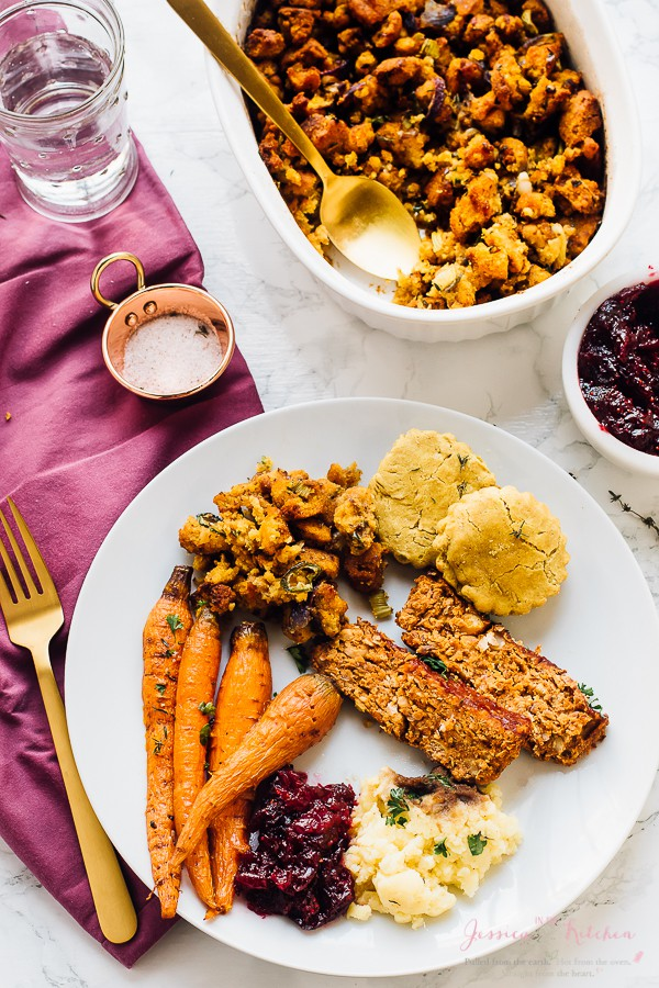 Gluten free cornbread stuffing on a plate with carrots and meatloaf.
