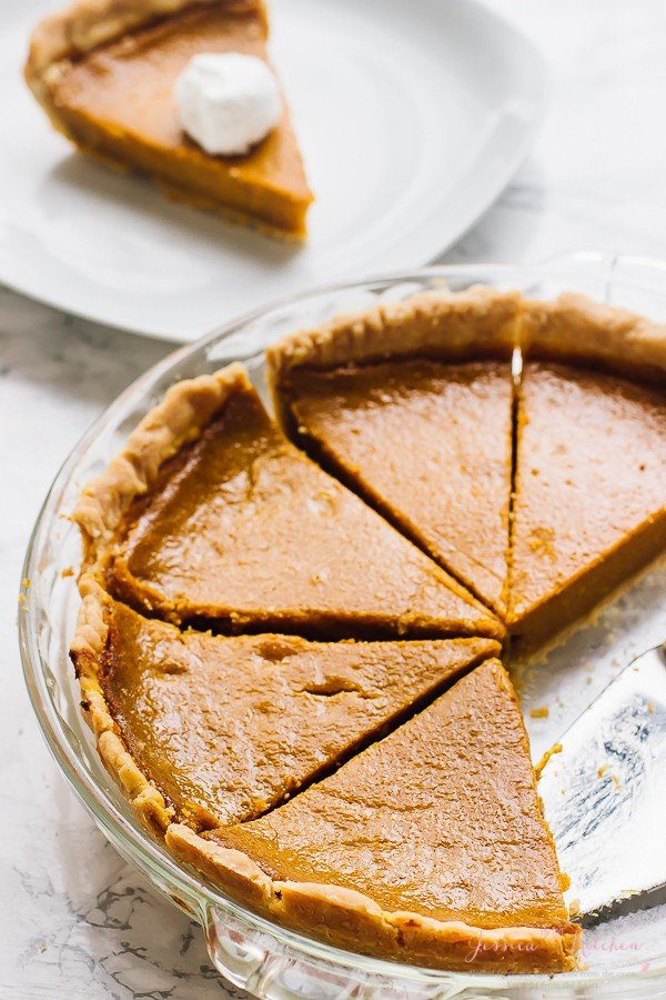 This Vegan Pumpkin Pie is made with coconut milk, homemade pumpkin puree and all natural healthy ingredients! It's refined-sugar free, gluten free and bakes JUST like classic pumpkin pie!