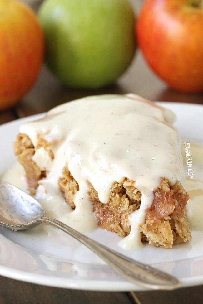 A slice of gluten free swedish apple pie with ice cream melting on top.