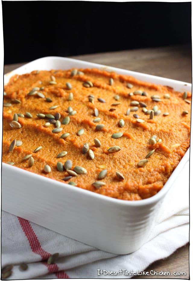 Pumpkin lentil shepherds pie in a white baking dish.