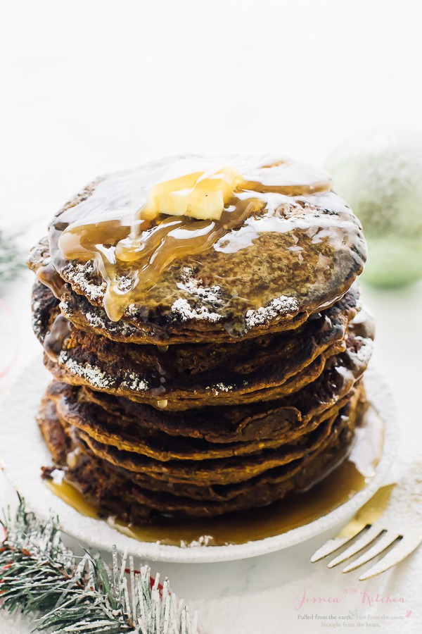 These Gingerbread Pancakes are like eating Gingerbread cookies for breakfast! Fluffy, so tasty, and served with a salted caramel maple syrup! via https://jessicainthekitchen.com