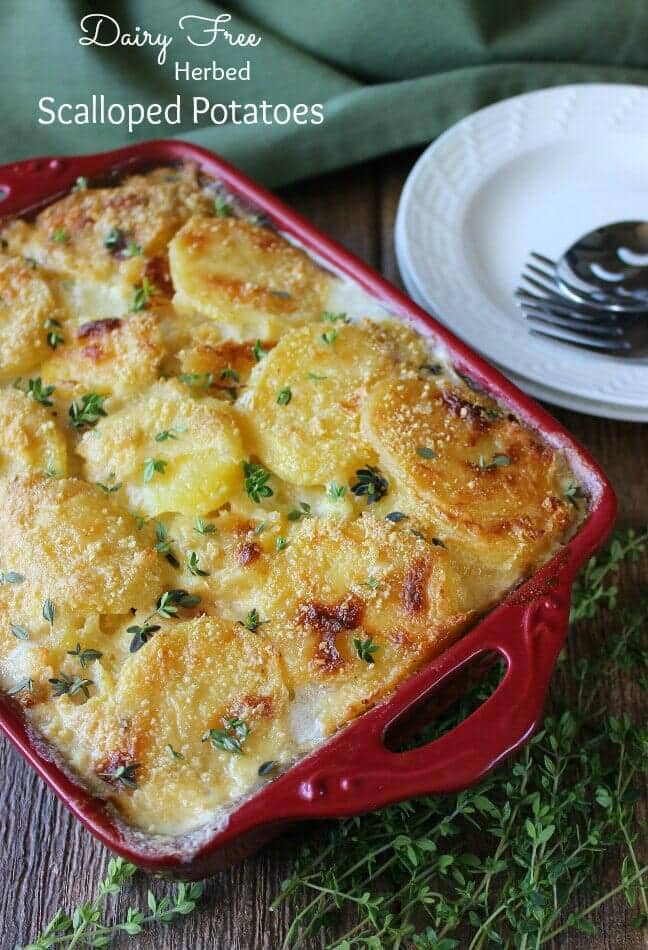 Dairy free scalloped potatoes in a red baking dish.