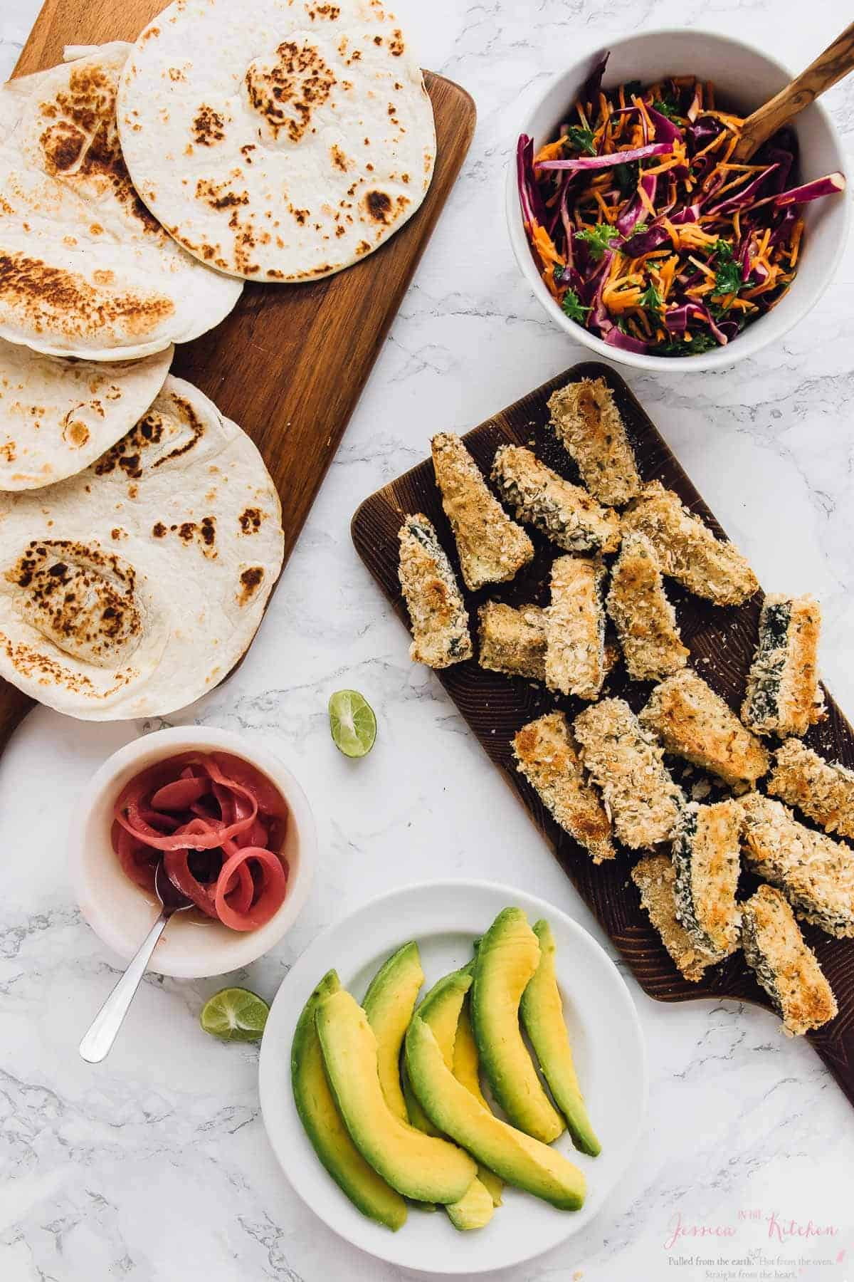 These Crispy Zucchini Tacos will impress you and your family or guests like crazy! Loaded with layers of flavour, so easy to make and topped with a dreamy lime crema! via https://jessicainthekitchen.com