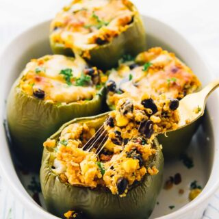 These Easy Quinoa Stuffed Peppers are made Tex-Mex Style! They are very filling, nutritious, and perfect for quick weeknight dinners! via https://jessicainthekitchen.com