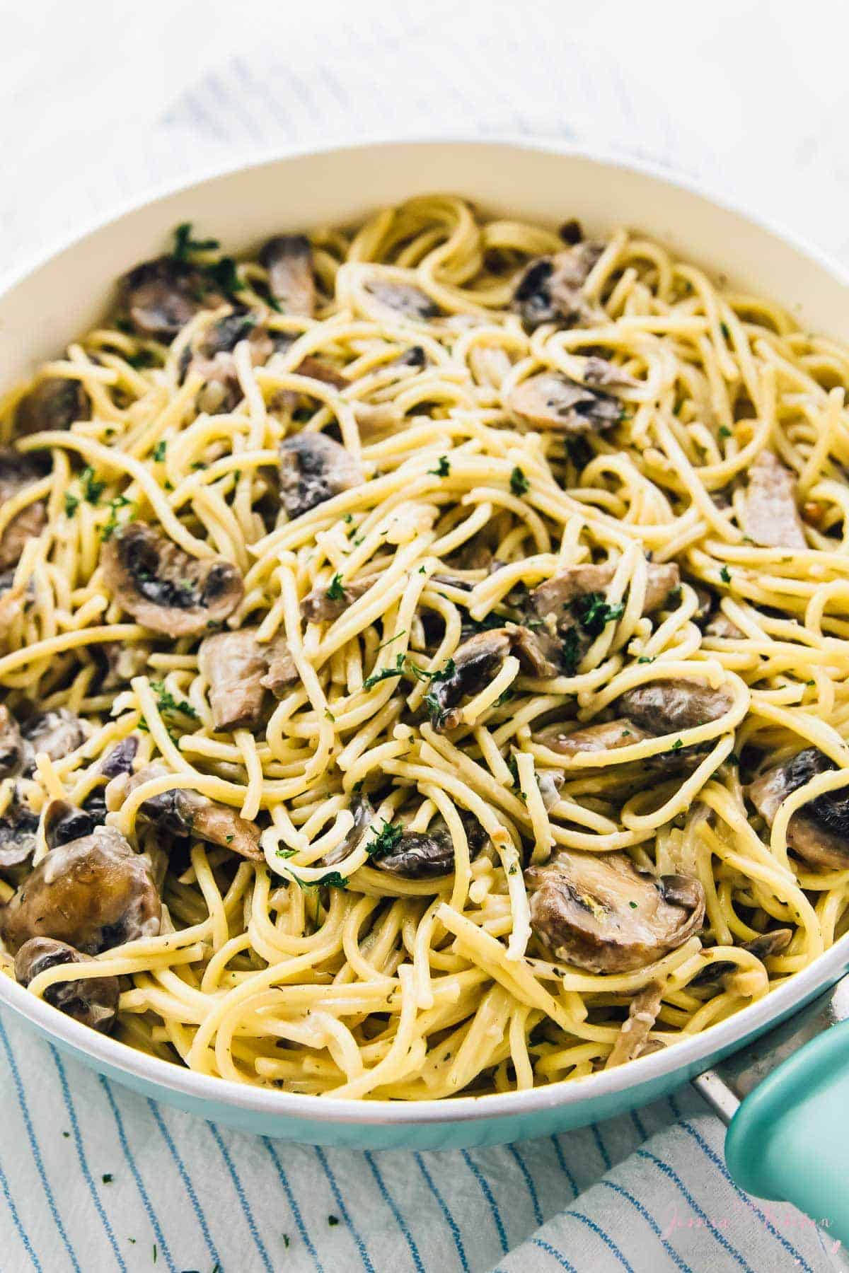 This Creamy Garlic Mushroom Pasta is done in just 30 minutes! It's absolutely mouthwatering, so easy to make, and makes tons of servings!