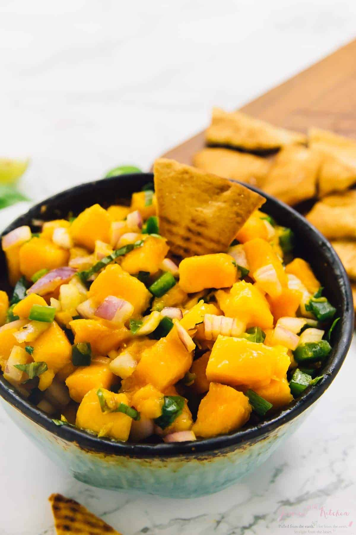 This Easy Mango Basil Salsa takes only 10 minutes with 5 ingredients! It's a sweet and spicy salsa that is a total crowd pleaser and great for parties! via https://jessicainthekitchen.com
