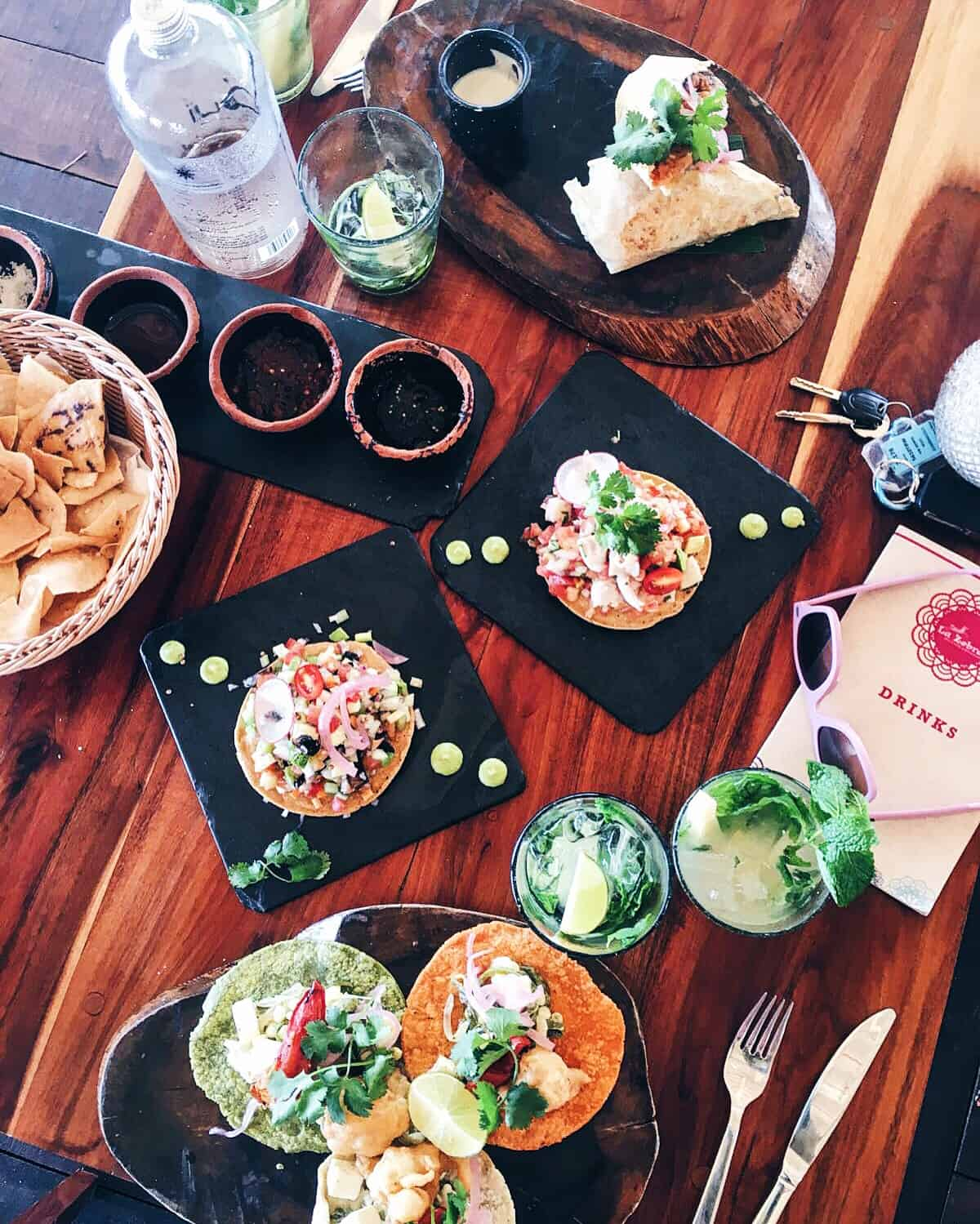 Overhead view of tostadas on a wood table.