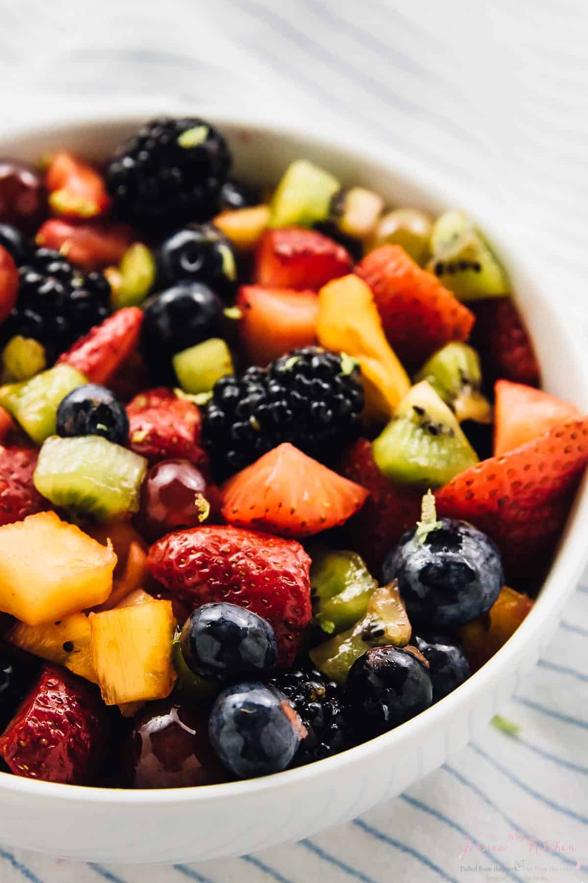 This beautiful Rainbow Fruit Salad with Maple Lime Dressing is loaded with so much delicious fruit flavour! It's a perfect quick snack, breakfast or even dessert and is vegan! via https://jessicainthekitchen.com
