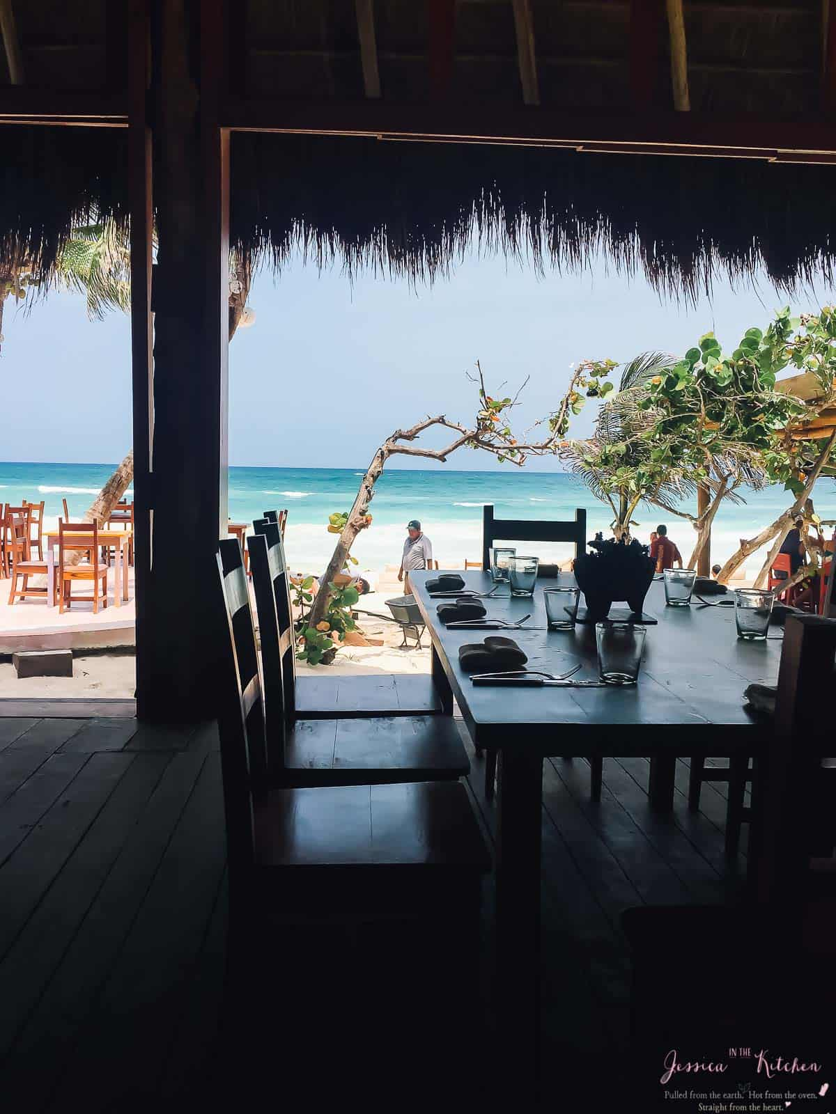 Inside a restaurant looking out to the beach.