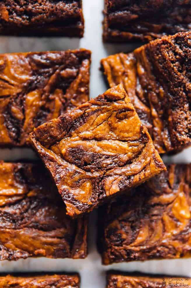 These Vegan Pumpkin Cheesecake Swirl Brownies will amaze your tastebuds and your guests!! They taste fantastic and are so easy to make! via https://jessicainthekitchen.com