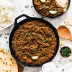Top down view of red lentil curry in a skillet.