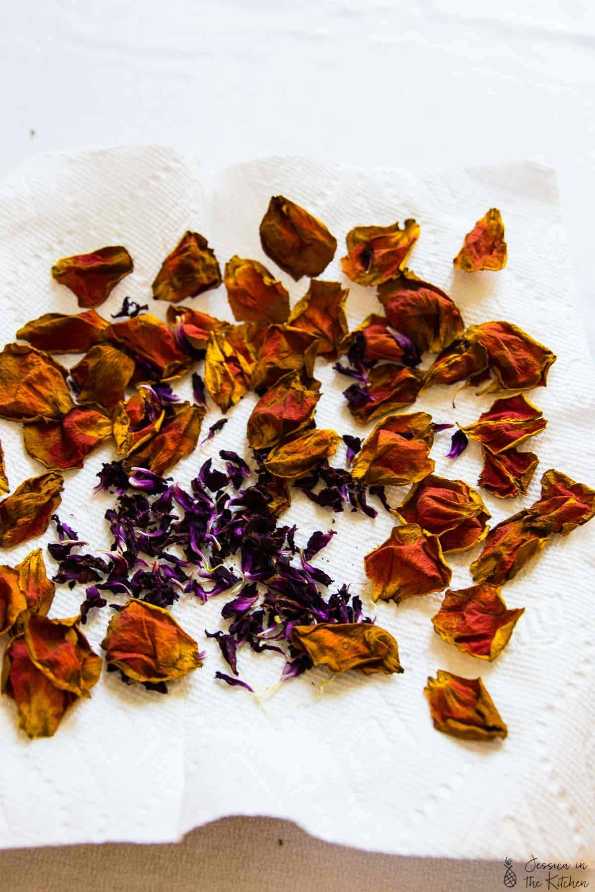 Top down shot of dried petals on a kitchen towel.
