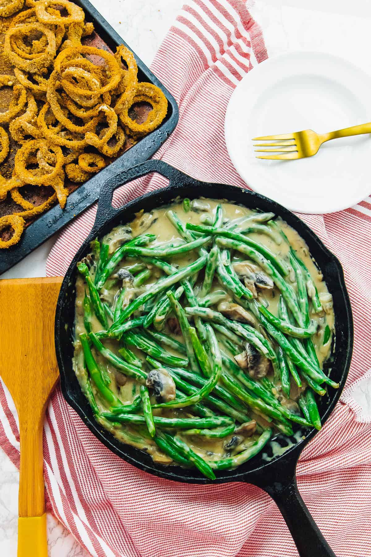 Green bean casserole ingredients cooked and arranged.