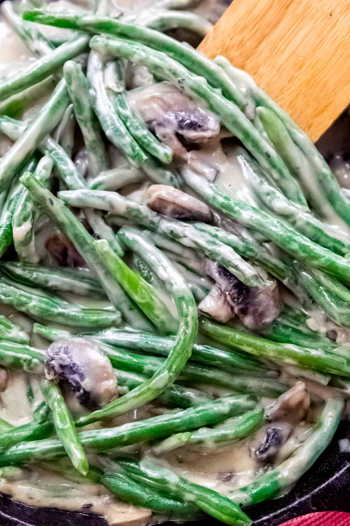 Mushrooms and green beans in coconut sauce casserole filling.