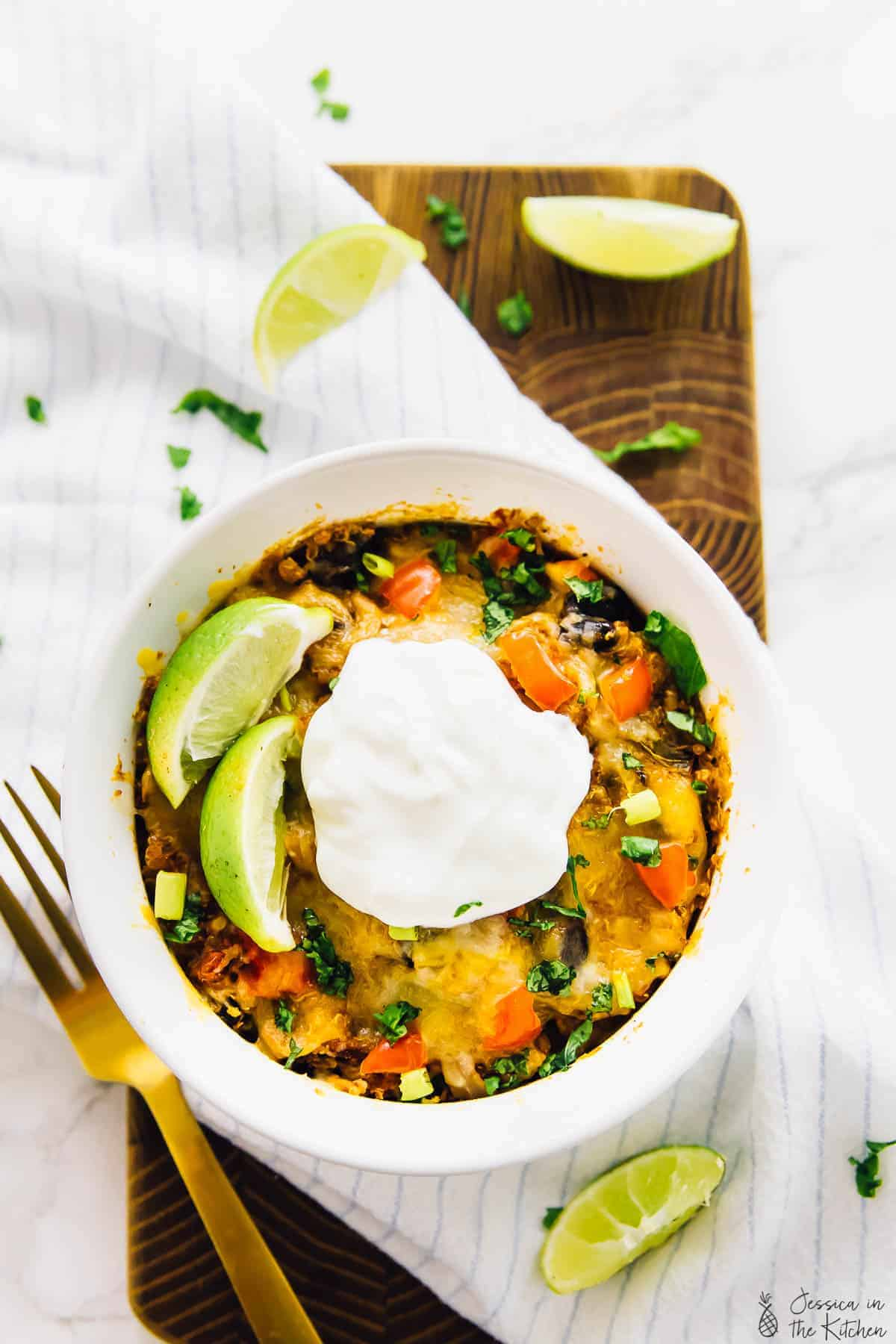 This healthy Slow Cooker Quinoa Enchilada Casserole takes only 15 minutes of prep, then add it all into the slow cooker! It's filling, serves lots of leftover and is bursting with flavour! via https://jessicainthekitchen.com