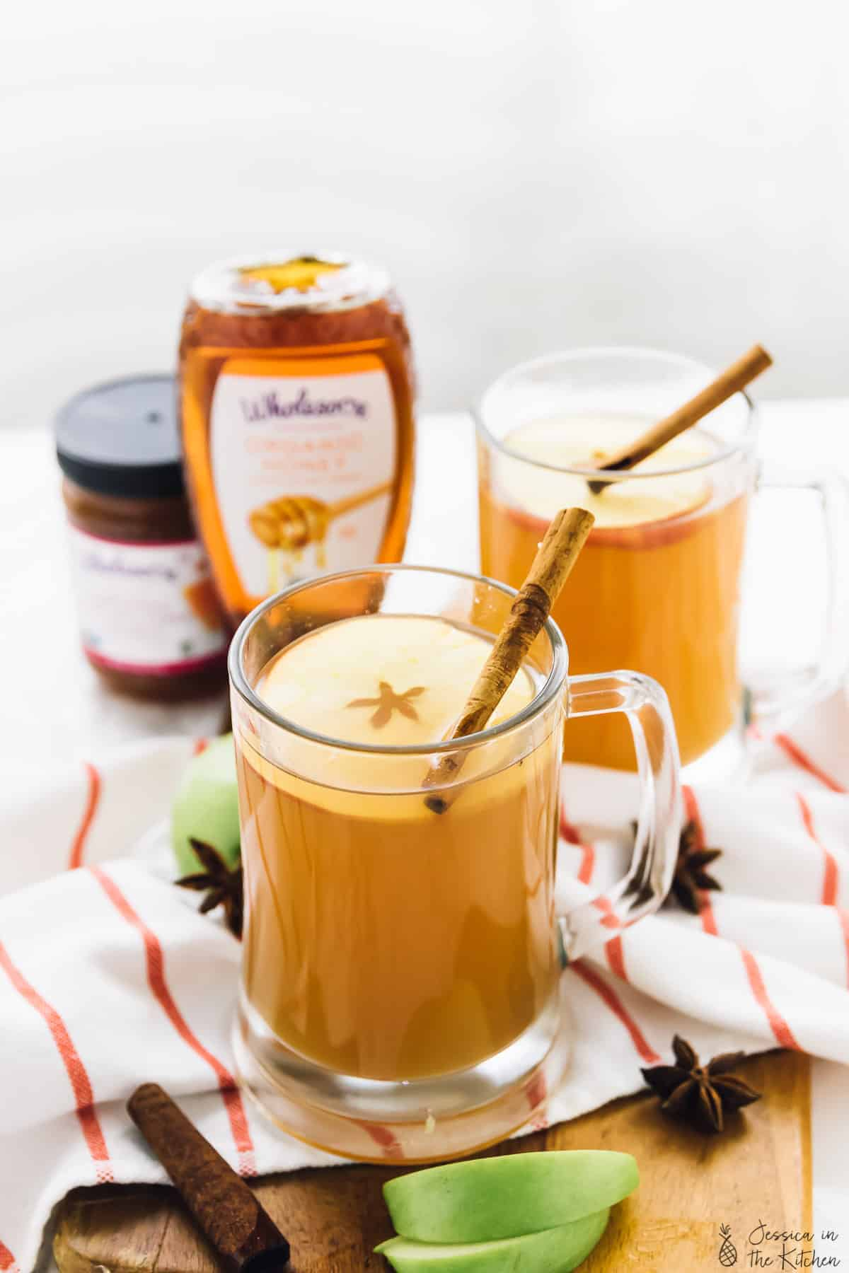 This Warm Spiced Apple Cider will warm you up this holiday season! It's made in your slow cooker, makes your house divinely fragrant, and tastes absolutely amazing! via https://jessicainthekitchen.com