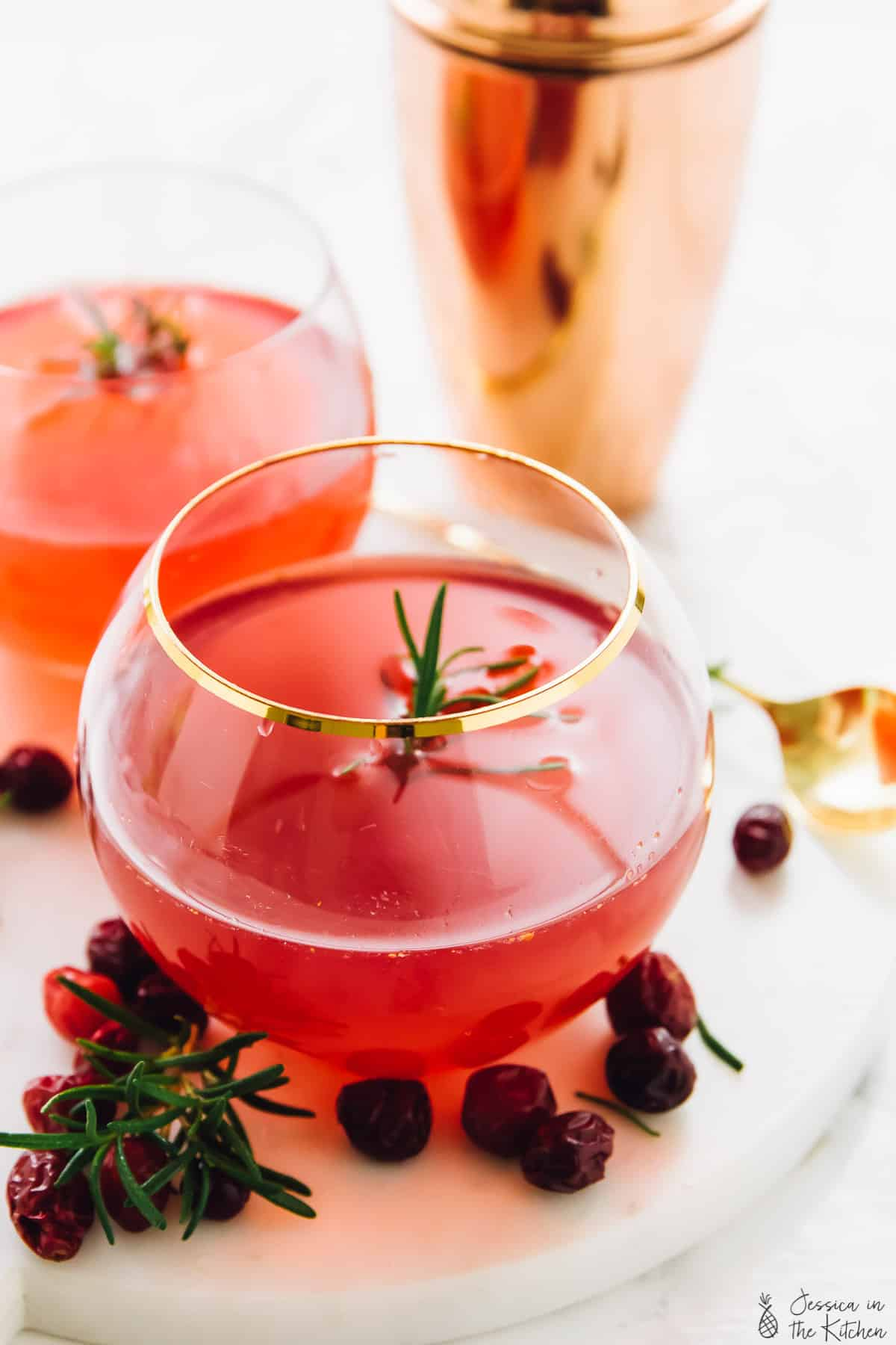 This Winter Cranberry Gin Cocktail will impress all of your guests! It's made with an easy rosemary infused simple syrup and only a few ingredients!