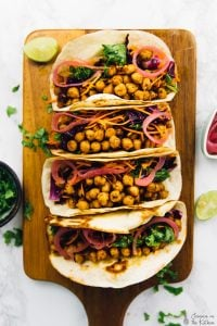 These BBQ Chickpea Tacos make such an easy and flavourful dinner recipe! The chickpeas are coated in caramelised bbq sauce, and it's all served with pickled onions and a divine kale and cabbage slaw!Vegan and great for Super Bowl! via https://jessicainthekitchen.com