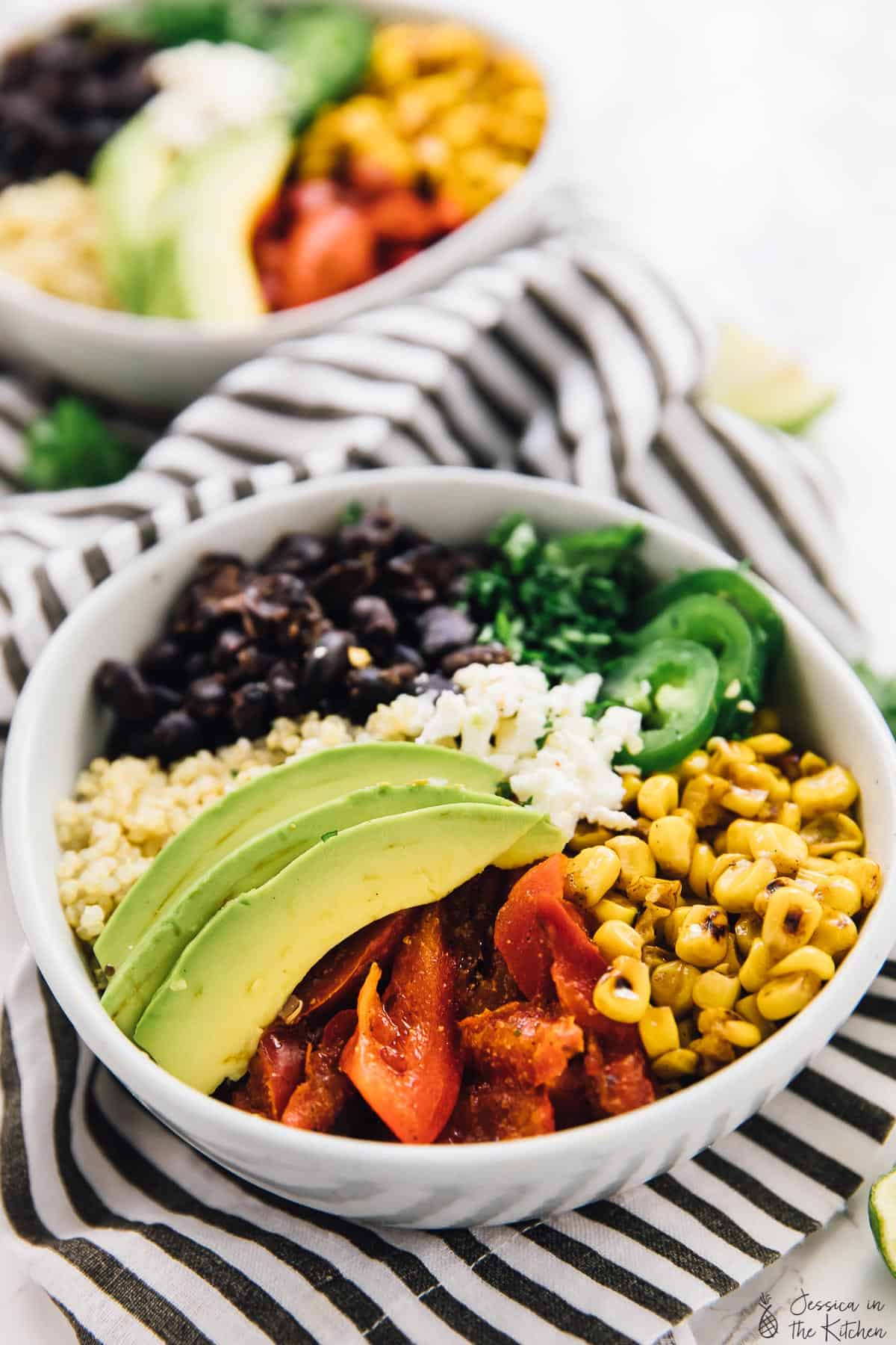 These Mexican Street Corn Burrito Bowls are the healthier, but just as tasty, versions of your favourite burrito! The bowls are drizzled with a creamy and smooth lime crema for a filling and delicious dish that's perfect for meal prep! via https://jessicainthekitchen.com