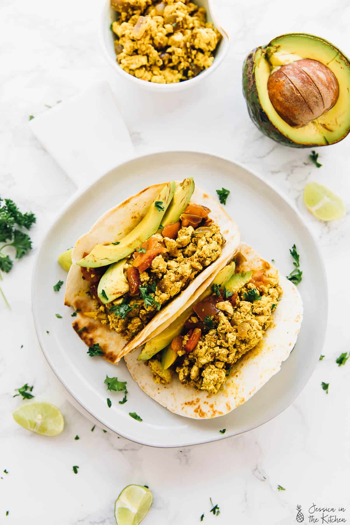 This Easy Tofu Scramble will become your new vegan breakfast idea!! It's beyond simple to make and you can even make it into breakfast tacos! via https://jessicainthekitchen.com