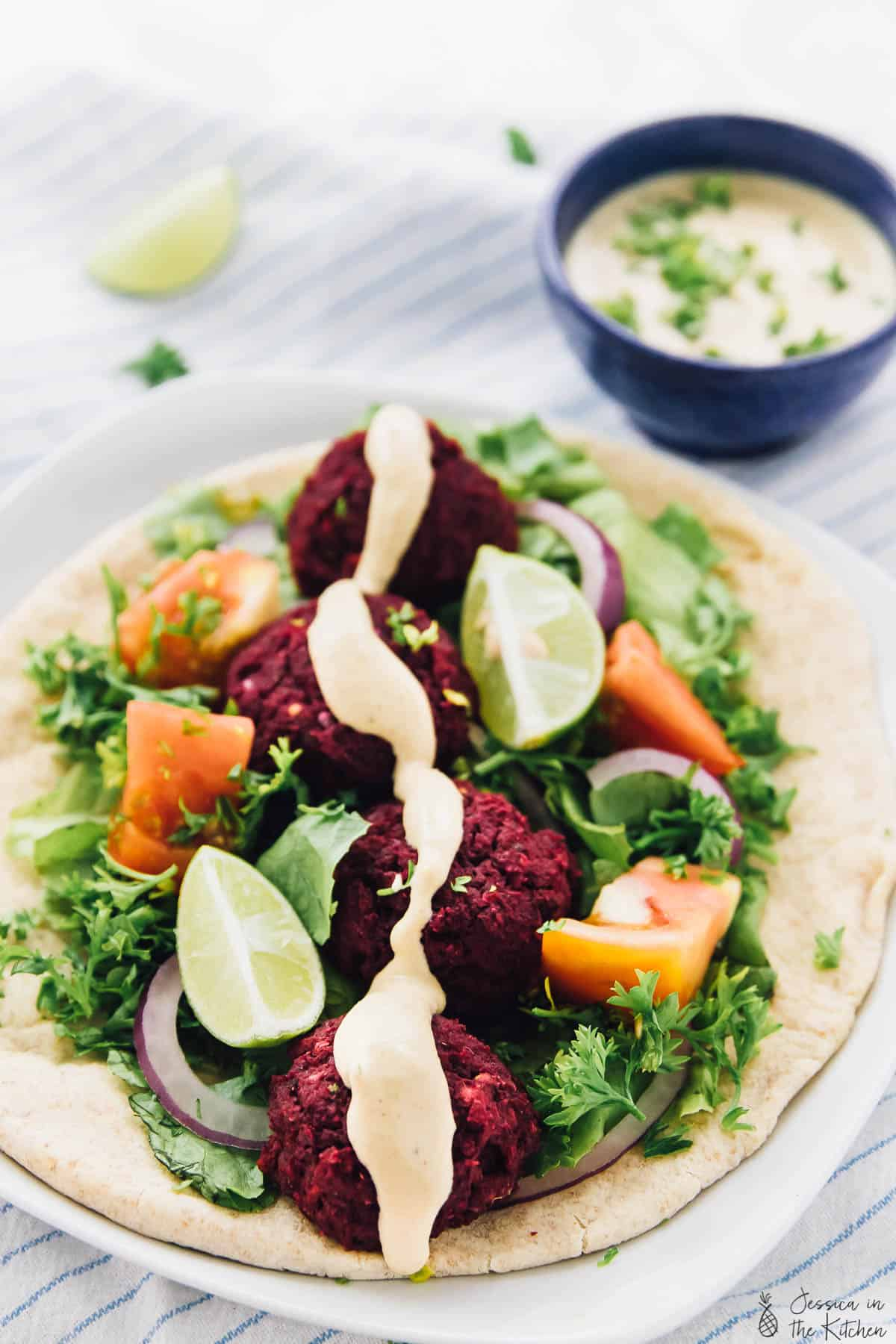 This beet falafel is a beautiful colour twist on your traditional favourite falafel! It's baked instead of fried and tastes absolutely delicious!! via https://jessicainthekitchen.com