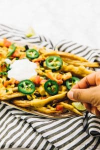 You NEED these Vegan Loaded Nacho Fries for your next party! They are loaded with my favourite vegan nacho cheese sauce and are SO delicious!! via https://jessicainthekitchen.com