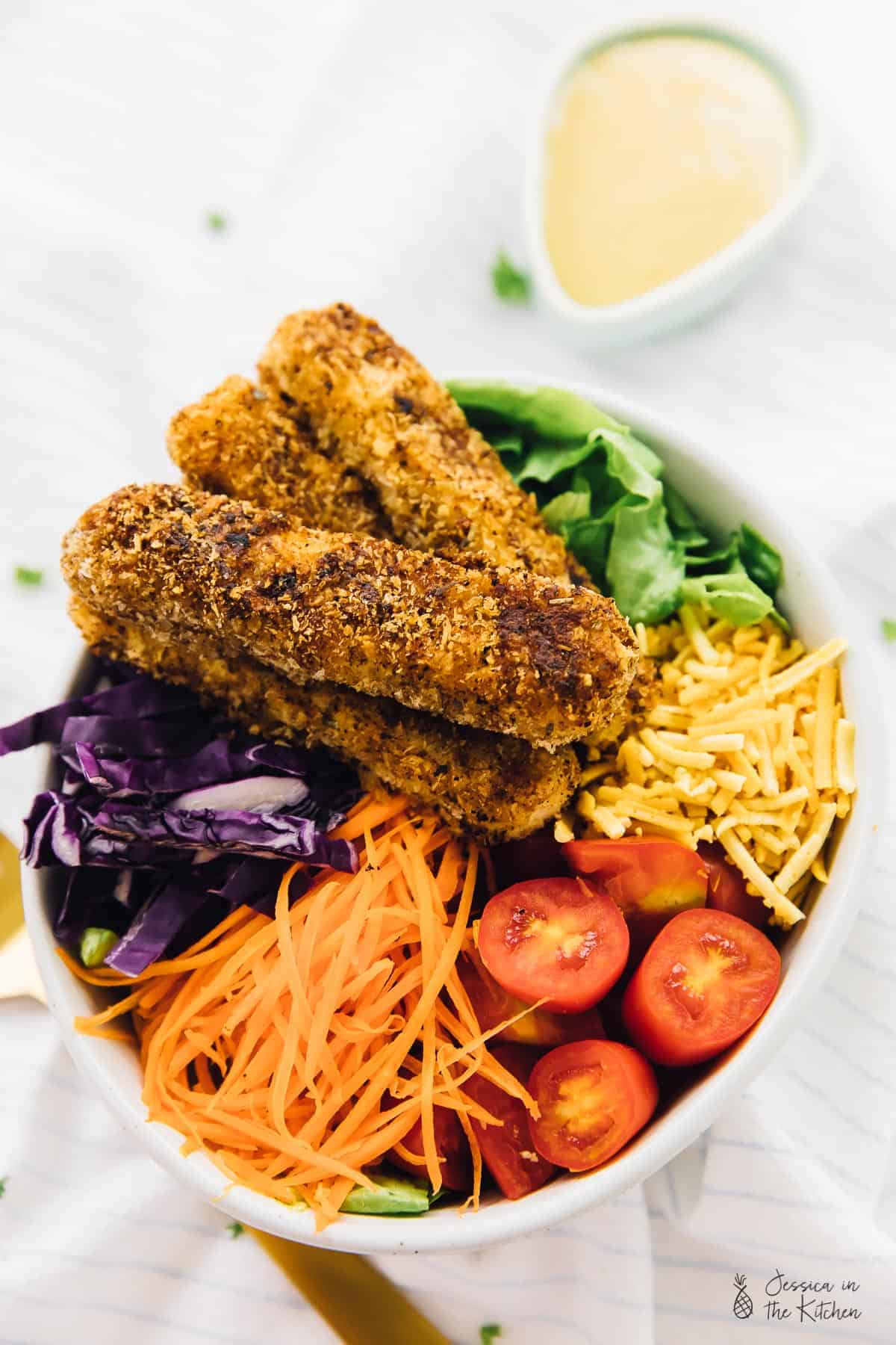 ThisVegan Crispy Cajun Fried Chicken Salad with Honey Mustard Dressing is the ultimate healthy indulgent salad! It's topped with a vegan version of Honey Mustard Dressing and SO crave-worthy! via https://jessicainthekitchen.com