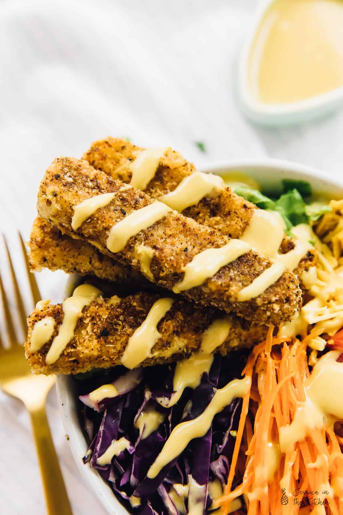 This Vegan Crispy Cajun Fried Chicken Salad with Honey Mustard Dressing is the ultimate healthy indulgent salad! It's topped with a vegan version of Honey Mustard Dressing and SO crave-worthy! via https://jessicainthekitchen.com