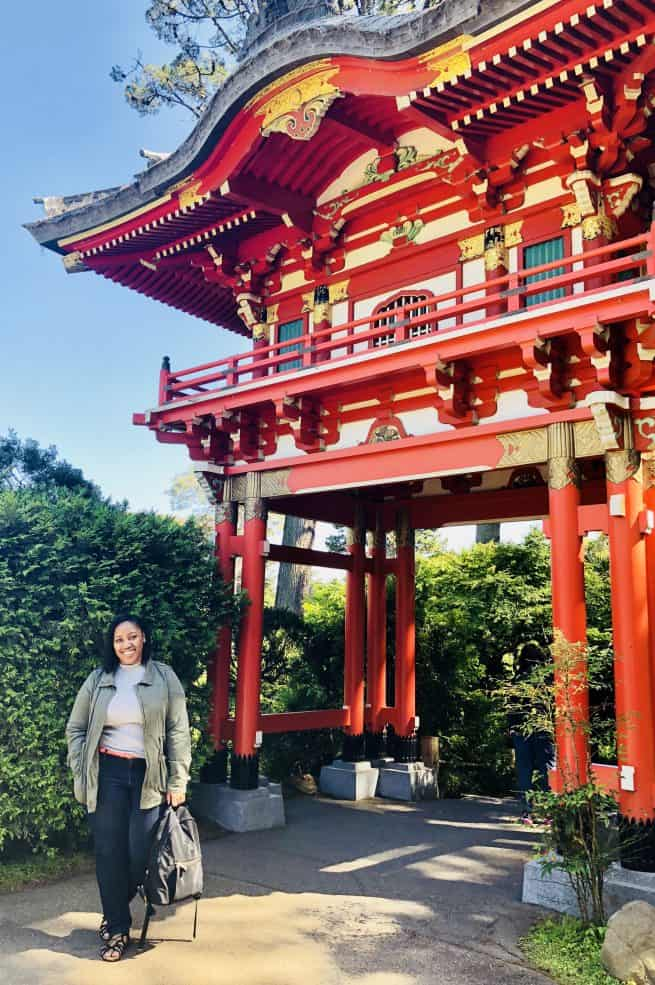 Jessica next to a pagoda.