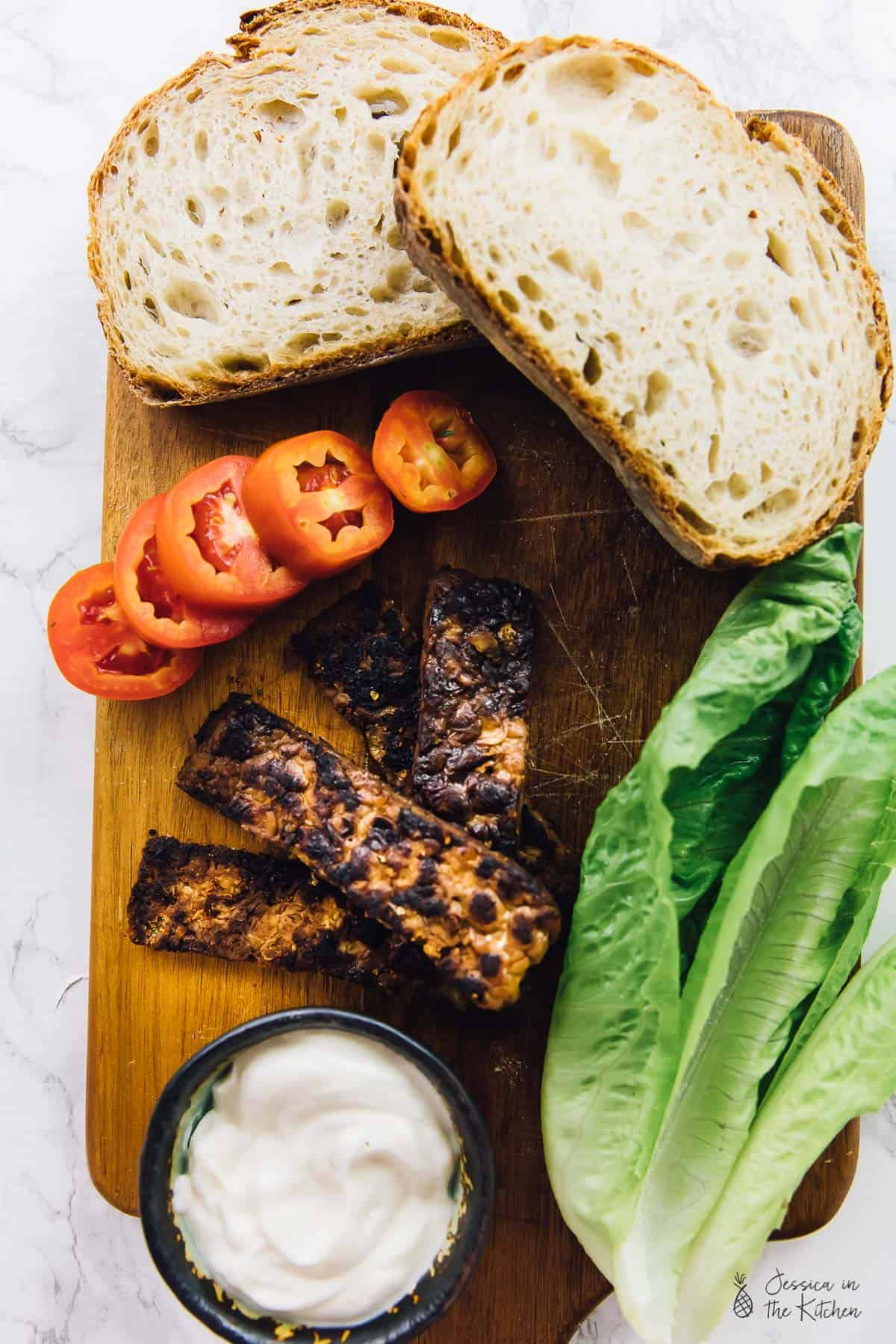 This Tempeh Bacon BLT Sandwich is loaded with lots of meaty flavour! It's perfect for quick lunches and dinners and you can use the tempeh bacon in so many ways! via https://jessicainthekitchen.com