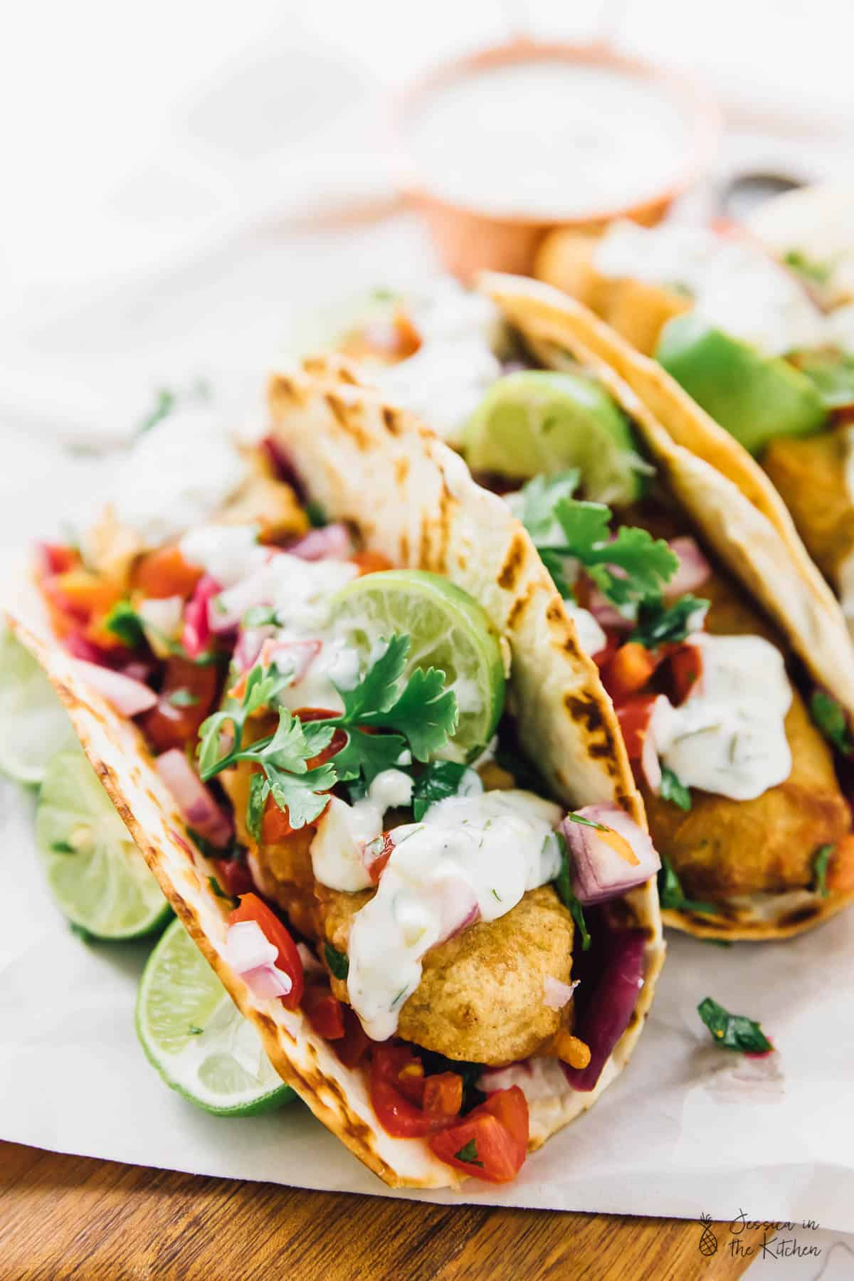 This Vegan Fish Tacos are a real vegan treat!! A beer-battered crust, flavourful pico de gallo and a creamy tartar sauce make for the ultimate vegan taco experience! via https://jessicainthekitchen.com