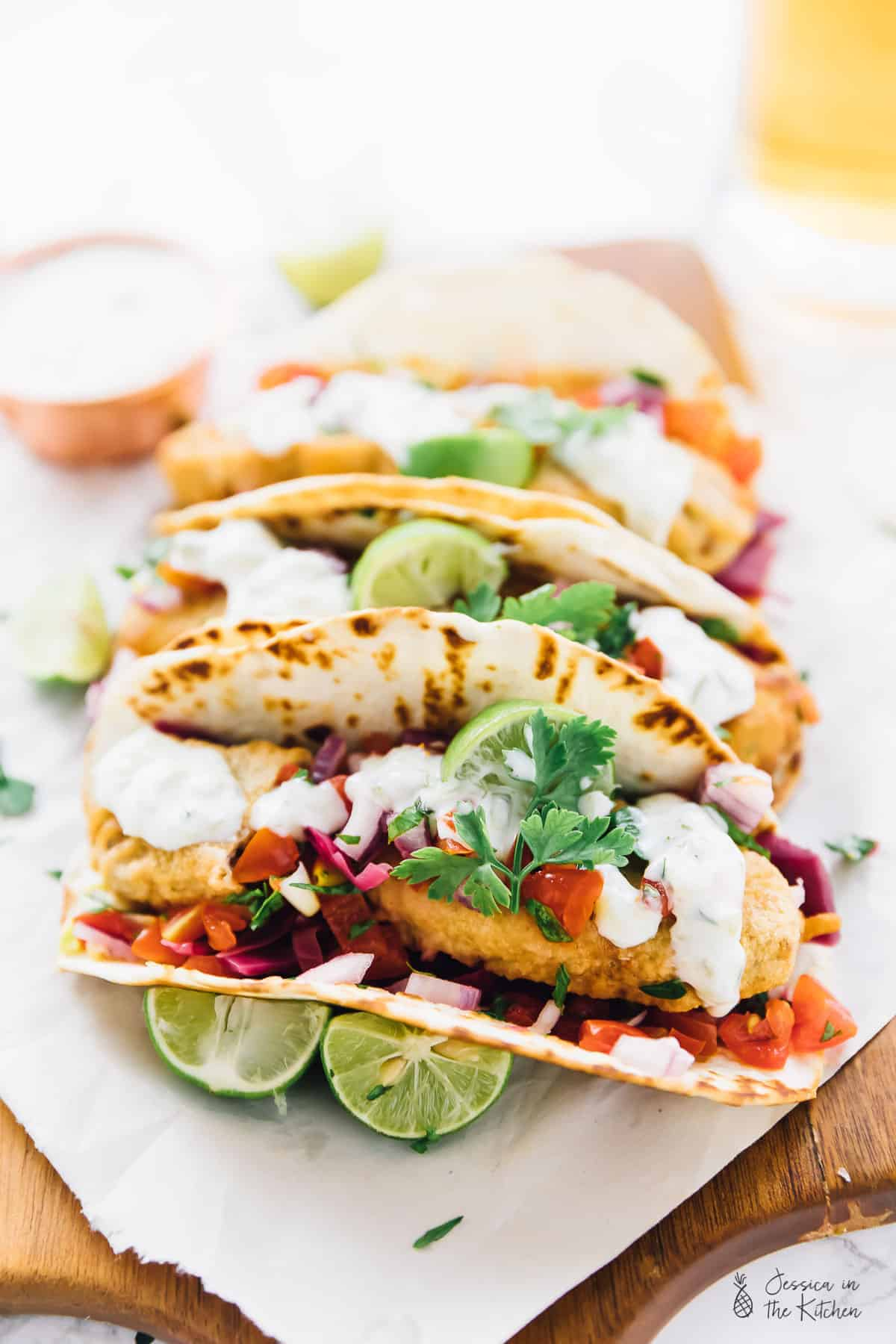 ThisVegan Fish Tacos are a real vegan treat!! A beer-battered crust,flavourful pico de gallo and a creamy tartar sauce make for the ultimate vegan taco experience! via https://jessicainthekitchen.com