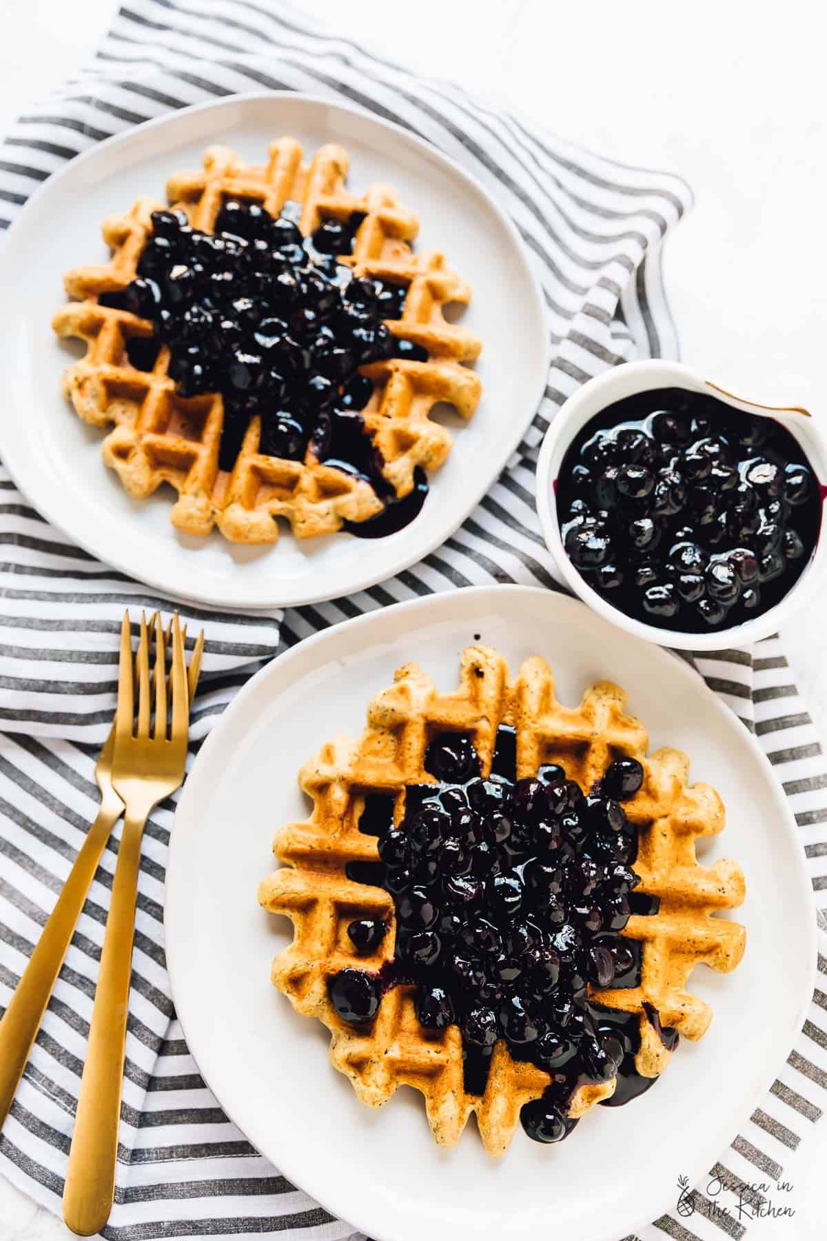 These Lemon Poppyseed Waffles are bursting with flavour! They're drizzled with a divine vanilla blueberry sauce, and are vegan and gluten free! via https://jessicainthekitchen.com