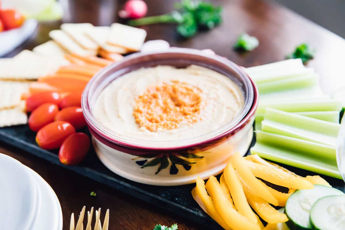 Here's an incredibly easy recipe for How to Create an Easy Crudité Platter! I love them because they look absolutely stunning, with very little effort! You don't need to cook or mix anything, just cut, serve and enjoy! This platter features amazing hummus dips and crunchy, easy-to-prep veggies! via https://jessicainthekitchen.com #sponsored @sabradips #vegan #crudite #glutenfree #party #summer #summerideas #summerparty #recipeideas #partyideas