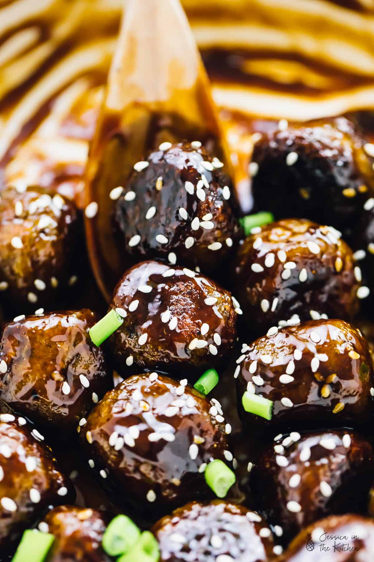 These Vegan Teriyaki Meatballs have the perfect texture and taste divine! They are incredibly easy to make, coated in a homemade sweet and sticky teriyaki sauce and so meal preppable! via https://jessicainthekitchen.com #vegan #veganmeatballs #teriyaki #teriyakimeatballs #veganmealprep #mealprep #glutenfree #easyrecipes #vegetarian #veganrecipes