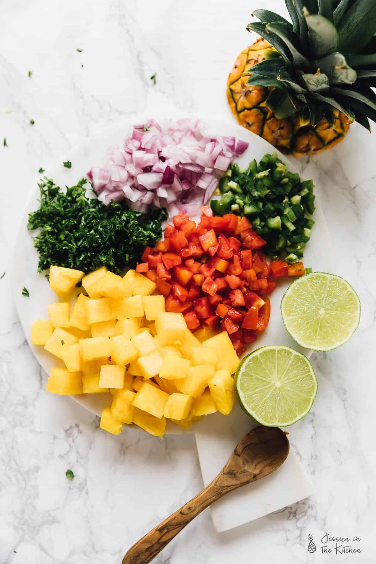 This Easy Pineapple Salsa Recipe takes only 10 minutes with 7 ingredients! It's a sweet and spicy salsa that is a total crowd pleaser and great for parties! via https://jessicainthekitchen.com