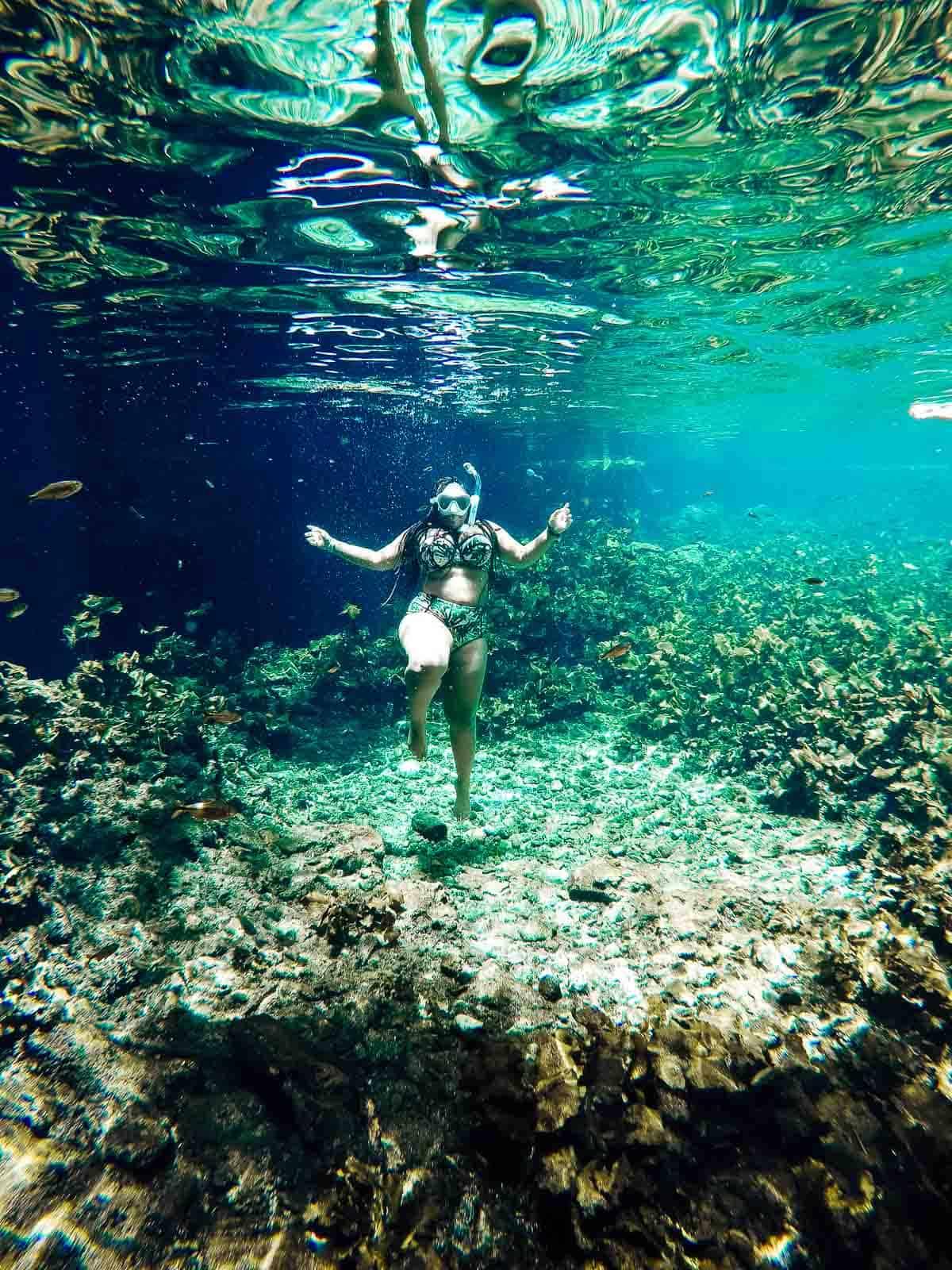 Jessica underwater, scuba diving.